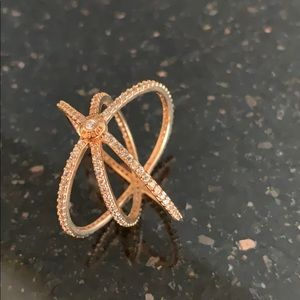Rose gold tone metal with crystals